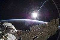 The International Space Station Backdropped by the Bright Sun over Earth's Horizon - various sizes