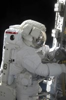 An Astronaut Performs a Task on the Exterior of the International Space Station - various sizes
