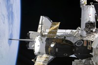 A Docked Soyuz Spacecraft over the Docked Space Shuttle Atlantis - various sizes