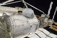 The Pressurized Mating Adapter 3 in the Grasp of the Canadarm2 - various sizes