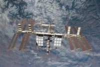 The International Space Station Backdropped by a Rugged Earth Terrain - various sizes