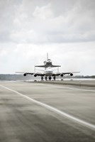 Space shuttle Discovery Sits Atop the Boeing 747 Shuttle Carrier Aircraft - various sizes