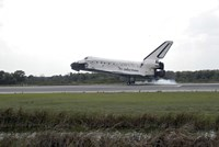 Space Shuttle Discovery Touches Down on the Runway at Kennedy Space Center - various sizes