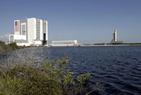 Viewed across the Basin, Space Shuttle Atlantis Crawls Toward the Launch Pad - various sizes