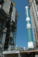 The Mobile Service Tower approaches the Delta II Rocket - various sizes