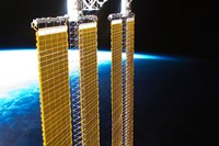A Partial View of International Space Station Solar Panels and Earth's Horizon - various sizes