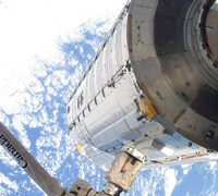 The Kibo Japanese Pressurized Module in the Grasp of the Robotic Canadarm2 - various sizes