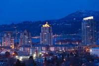 British Columbia, Okanagan Valley, Kelowna Skyline by Walter Bibikow - various sizes