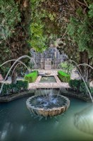 Spain, Granada A Fountain in the gardens of the Alhambra Palace Fine Art Print
