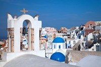 Bell tower and blue domes of church in village of Oia, Santorini, Greece Fine Art Print