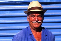 Close Up of Native Man with Blue Wall, Athens, Greece by Bill Bachmann - various sizes