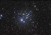 NGC 457 is an open star cluster in the Constellation Cassiopeia Fine Art Print