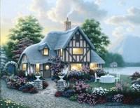 Lakeside Cottage Framed Print