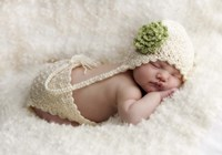 Baby In Green And White Framed Print