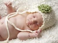 Baby White Cap Green Flower Framed Print