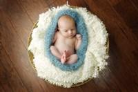 Baby In Blue Pod Framed Print