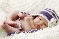 Baby In Lavender And White Cap Fine Art Print