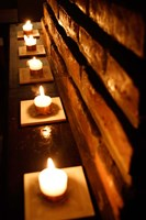 Lighted Candles and Brick Wall Fine Art Print