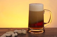 Beer Foaming And Peanuts Fine Art Print