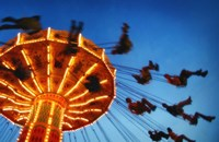 Adults Riding a Carnival Swing Game Fine Art Print