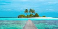 Jetty and Maldivian island Fine Art Print