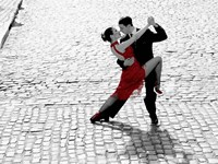 Couple Dancing Tango on Cobblestone Road Framed Print