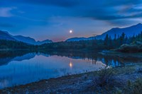Crescent moon over Middle Lake in Bow Valley, Alberta, Canada Fine Art Print