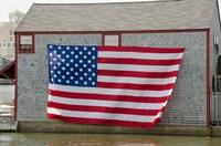 Massachusetts, Nantucket, Flag on boathouse Fine Art Print