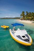 Powerboat and banana boat, Plantation Island Resort, Malolo Lailai Island, Mamanuca Islands, Fiji Fine Art Print