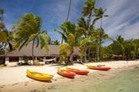 Kayak on the beach, and waterfront bure, Plantation Island Resort, Malolo Lailai Island, Mamanuca Islands, Fiji Fine Art Print