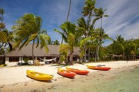 Kayak on the beach, and waterfront bure, Plantation Island Resort, Malolo Lailai Island, Mamanuca Islands, Fiji Fine Art Print