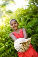 Village boy with large sea shell, Beqa Island, Fiji Fine Art Print