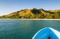 Blue boat cruising through the Yasawa, Fiji, South Pacific Fine Art Print