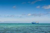 Fishing boat in the turquoise waters of the blue lagoon, Yasawa, Fiji, South Pacific Fine Art Print