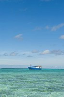 Fishing boat in the turquoise waters of the blue lagoon, Fiji Fine Art Print