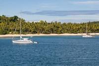 Little sailboat in the blue lagoon, Yasawa, Fiji, South Pacific Fine Art Print