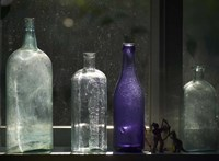 Still Life With Bottles And Found Figurines Fine Art Print