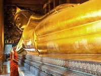 Praying the reclined Buddha, Wat Pho, Bangkok, Thailand Fine Art Print