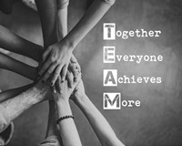 Together Everyone Achieves More - Stacking Hands Grayscale Framed Print