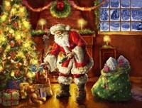 Santa putting gifts under tree Fine Art Print