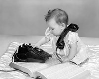 1960s Baby Girl With Telephone Book Fine Art Print