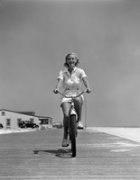 1940s Summer Time Smiling Woman Riding Bike On Beach Boardwalk Fine Art Print