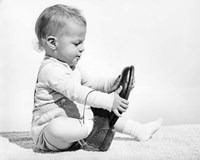 1960s Baby Boy Trying To Put On Man'S Shoe Fine Art Print