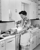 1950s Housewife In Kitchen Mixing Ingredients Fine Art Print
