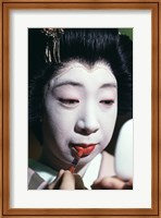 Close-up of a geisha applying lipstick to her lips Fine Art Print