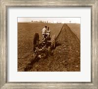 USA, Pennsylvania, Farmer on Tractor Plowing Field Fine Art Print