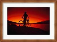 Silhouette of a man standing with a bike, Lake Powell, Utah Fine Art Print