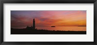 Silhouette of a lighthouse at sunset, Scotland Fine Art Print