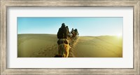 Row of people riding camels through the desert, Sahara Desert, Morocco Fine Art Print