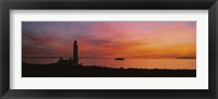 Silhouette of a lighthouse at sunset, Scotland Fine Art Print